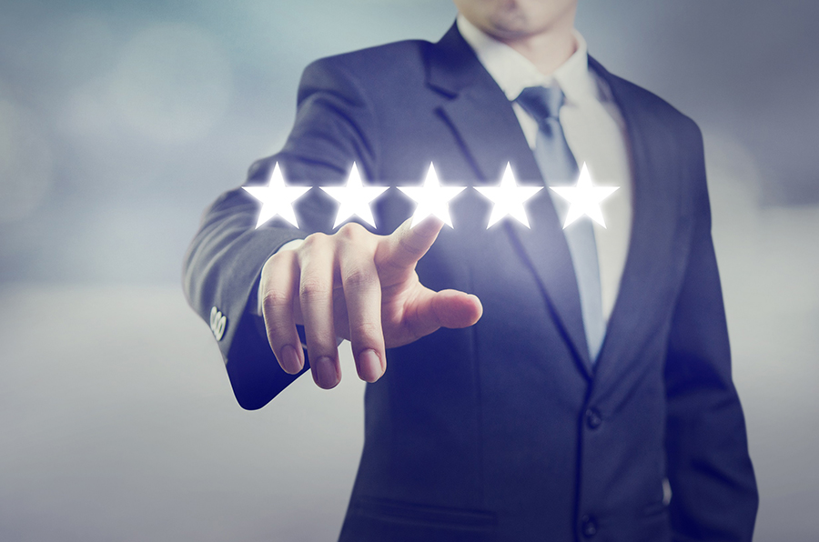 image of man pointing to five stars