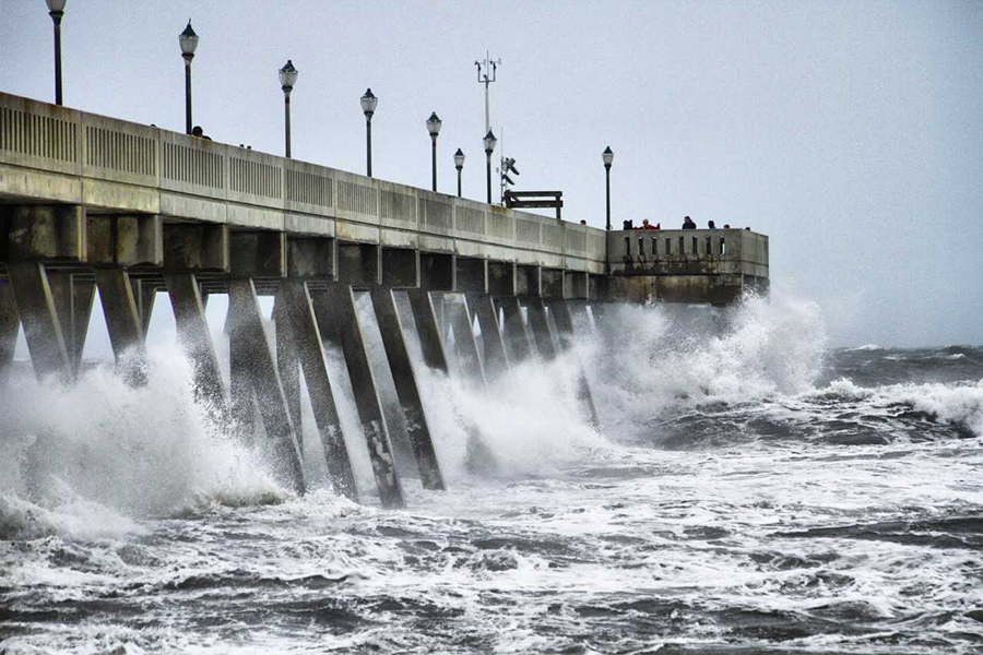 image of water crashing against a pier