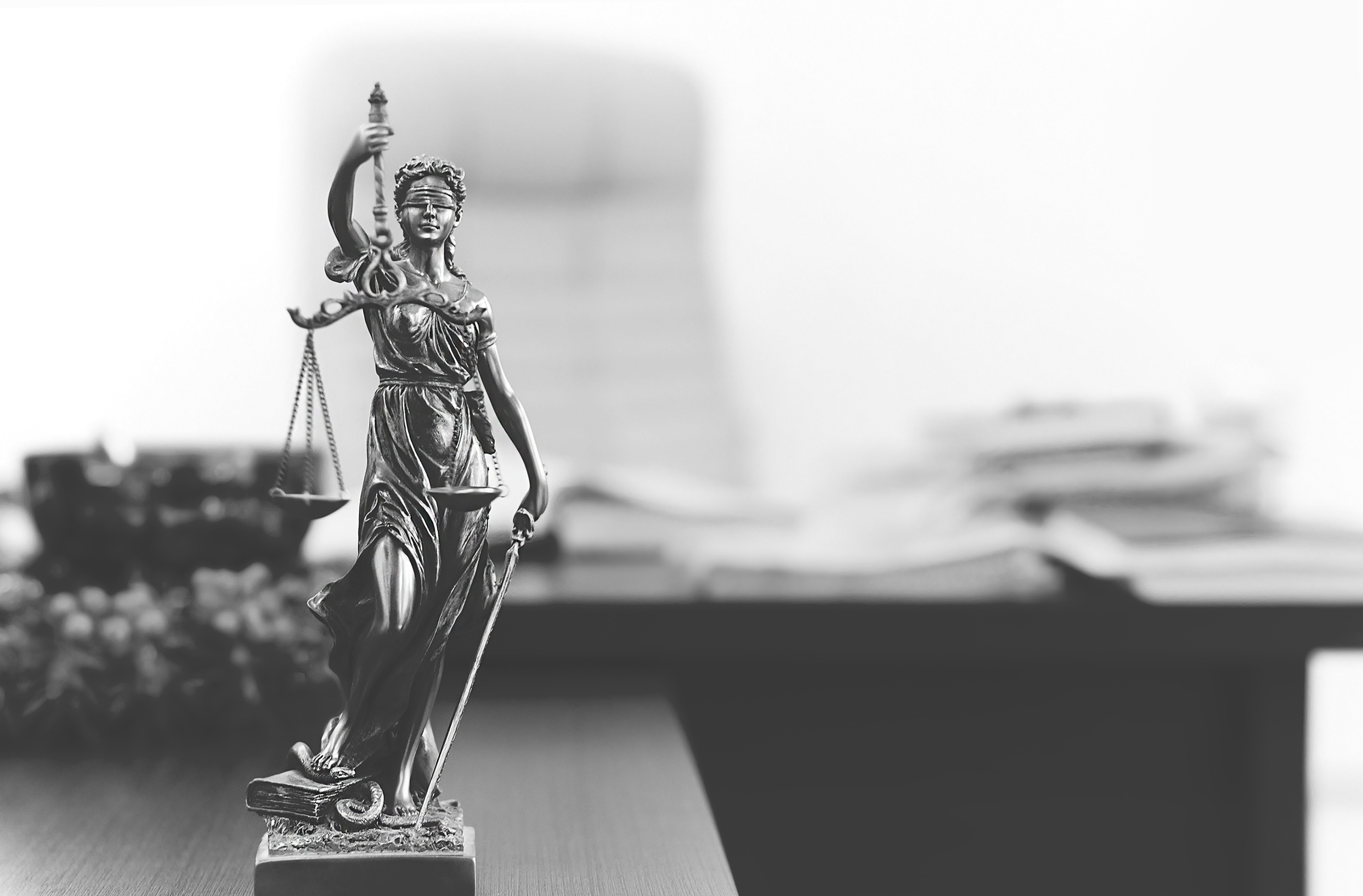 scales of justice figure on desk