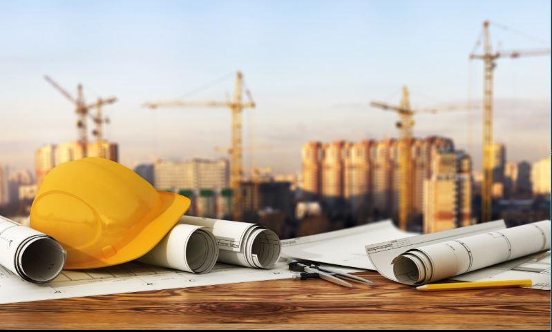 blueprints, hardhat, construction site