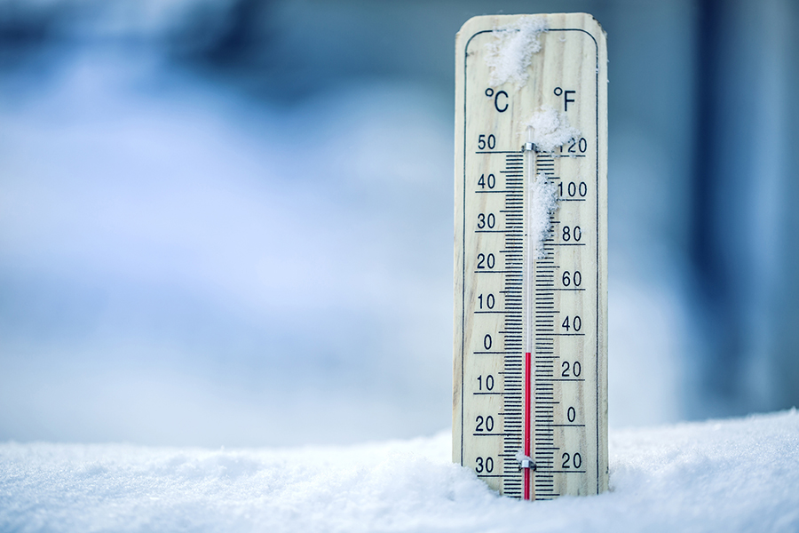 image of snow and thermometer representing winter weather maintenance