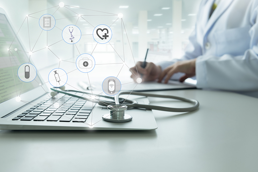 image of laptop and doctor representing virtual appointments