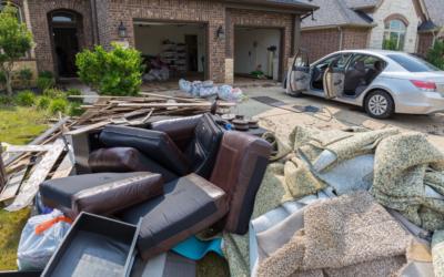 image of house/yard with flood damage mess