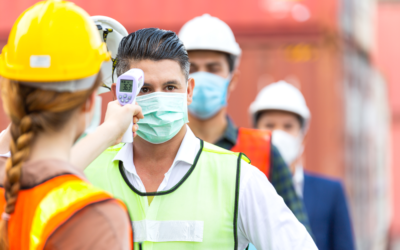 image of woman taking temperature of man at construction site