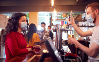 Male,Bartender,Wearing,Face,Mask,Serving,Female,Customer,With,Drink